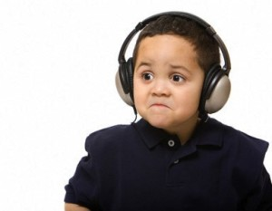 Sad boy with headphones not liking song choice