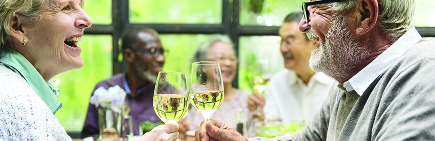 older Americans celebrating with wine