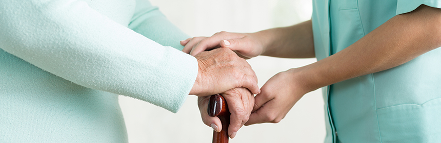 hands holding woman with cane