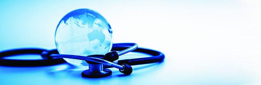 glass globe and stethoscope on table