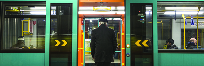 old man entering subway car