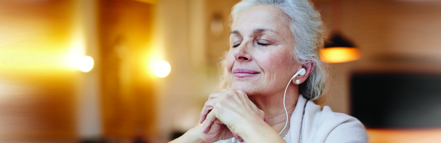old woman listening to music earbuds