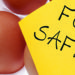 carton of eggs with food safety post it note