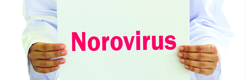norovirus sign held by doctor